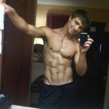 Good Looking Muscled Guy Show His Abs