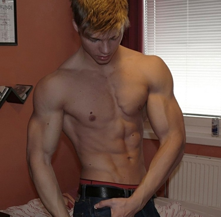 Sexy Smooth Muscle Boy Posing For The Camera